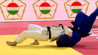Japan's Murayama fights his way to gold
