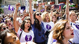 Swiss women take part in a nationwide general strike against working conditions in June 2019.