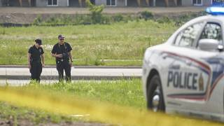 London Police investigate the scene of the attack in Ontario on Monday.