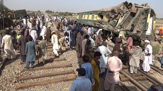 People working on the tracks after deadly train crash