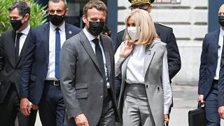 French President Emmanuel Macron (C) walks next to his wife Brigitte Macron before a lunch in Valence, on June 8, 2021,