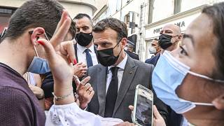 French President Emmanuel Macron talks to residents Tuesday June 8, 2021 in Valence