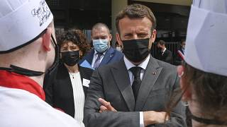 FILE: French President Emmanuel Macron talks with cooking students, Tuesday June 8, 2021 at the Hospitality school in Tain-l'Hermitage, southeastern France.