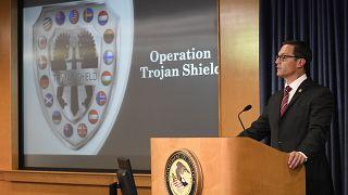 المدعي العام الأمريكي بالإنابة راندي غروسمان يتحدث في مؤتمر صحفي للإعلان عن عملية درع طروادة، الثلاثاء، 8 يونيو ، 2021