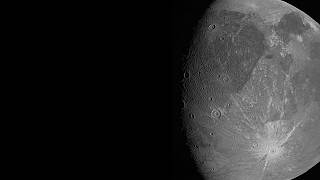 This June 7, 2021 image made available by NASA shows the Jovian moon Ganymede as the Juno spacecraft flies by