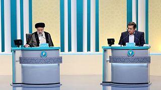 عبدالناصر همتی و ابراهیم رئیسی در دومین مناظره تلویزیونی انتخابات ۱۴۰۰