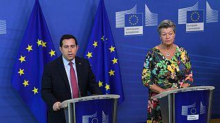 Greek Minister of Migration and Asylum Notis Mitarachi (L) and EU commissioner for Home Affairs Sweden's Ylva Johansson