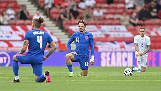 England's Jack Grealish takes a knee before the international friendly soccer match between England and Romania in Middlesbrough, England, Sunday, June 6, 2021.