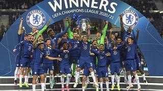 Chelsea's team captain Cesar Azpilicueta lifts the trophy at the end of the Champions League final match between Manchester City and Chelsea,  in Porto, Portugal, May 29, 2021