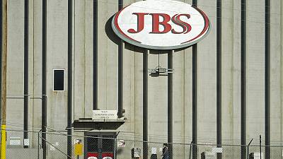A worker heads into the JBS meatpacking plant in Greeley, Colorado, US.