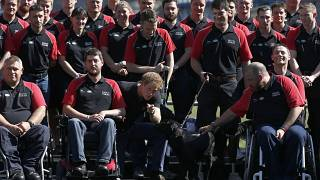 FILE - Britain's Prince Harry poses with the team during the announcement of the British Armed Forces team for the Invictus Games in London, Wednesday, Aug. 13, 2014