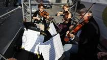 Budapest orchestra performs live concert from moving truck