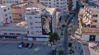 """A mural by Greek artist Fikos, who describes himself as a """"neo-muralist"""", is pictured on a building on Stasikratous Street"""
