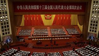 Delegates attend the opening session of China's National People's Congress (NPC) at the Great Hall of the People in Beijing on March 5, 2021.