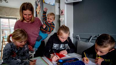 A mother homeschools her children amid a spike in parents opting to home-educate in the UK
