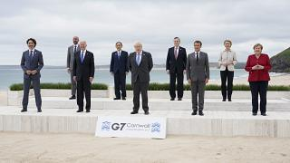 Leaders of the G7 pose for a group photo on overlooking the beach at the Carbis Bay Hotel in Carbis Bay, St. Ives, Cornwall, England, Friday, June 11, 2021.