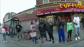 Police body camera shows Darnella Frazier, third from right filming, as former Minneapolis police officer Derek Chavin pressed his knee on George Floyd's neck May 25, 2020