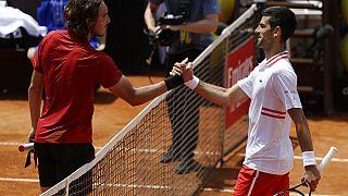 Serbia's Novak Djokovic greets Greece's Stefanos Tsitsipas, left