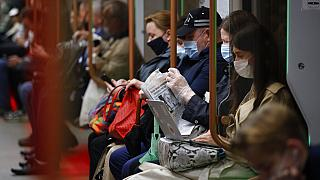 People wearing face mask to help curb the spread of the coronavirus ride a subway car in Moscow, Russia, Thursday, June 10, 2021.