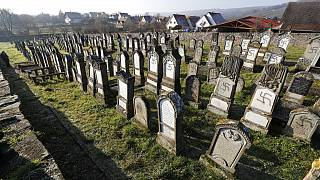 Vandalized tombs are pictured in the Jewish cemetery of Westhoffen, west of the city of Strasbourg, eastern France, Wednesday, Dec. 4, 2019.