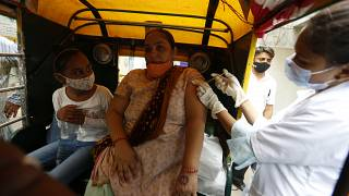 A physically disabled woman gets a dose of Covishield, Serum Institute of India's version of the AstraZeneca COVID-19 vaccine, in Ahmedabad, India, Saturday, June 12, 2021.