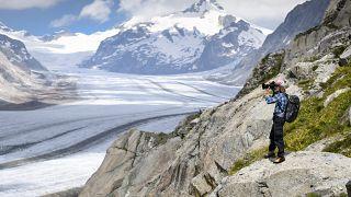 Swiss photographer David Carlier takes photographs of the Swiss Aletsch glacier, the longest glacier in Europe, in Fieschertal, Switzerland,  July 21, 2020.