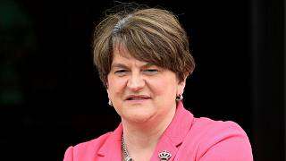 Arlene Foster looks at the media on the steps of parliament buildings, Stormont, Belfast, Northern Ireland, Tuesday, June 8, 2021.