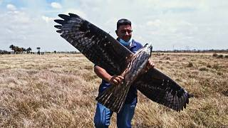 One of the Alasoluciones team holding their hawk drone.