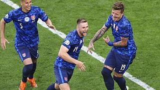 Slovakia's Milan Skriniar, centre, celebrates after scoring his side's second goal during the Euro 2020 soccer championship group E match between Poland and Slovakia