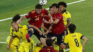 Spain's Aymeric Laporte goes for a header during the Euro 2020 soccer championship group E soccer match between Spain and Sweden