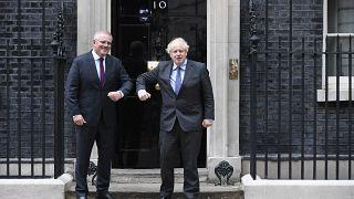 Britain's Prime Minister Boris Johnson, left, greets Australia's Prime Minister Scott Morrison at 10 Downing Street, in London, June 14, 2021.