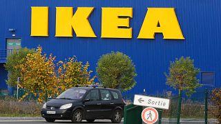 A car drives past the IKEA store in Plaisir, west of Paris, Nov. 20, 2013.