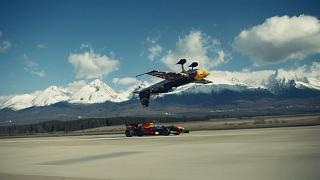 Red Bull F1 car driving very close to inverted race plane