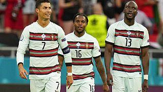 Portugal's Cristiano Ronaldo celebrates with his teammates Renato Sanches and Danilo Pereira