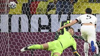 Germany's Mats Hummels, right, scores an own goal past Germany's goalkeeper Manuel Neuer during the Euro 2020.