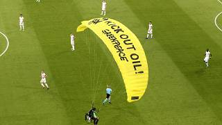 A Greenpeace paraglider lands at the Allianz Arena stadium in Munich prior to the Euro 2020 group F match between France and Germany, June 15, 2021.