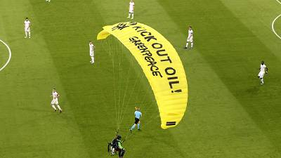 A Greenpeace paraglider lands at the Allianz Arena stadium in Munich prior to the Euro 2020 group F match between France and Germany, June 15, 2021