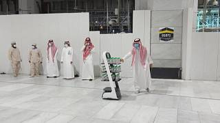 A smart robot with bottles of Zamzam water to reduce direct contact with staff to prevent COVID-19 infections during the yearly hajj pilgrimage.