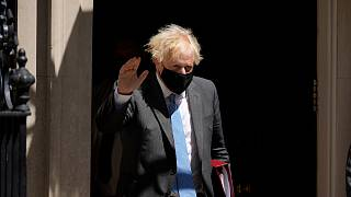 British Prime Minister Boris Johnson waves at the media as he leaves 10 Downing Street to attend the weekly Prime Minister's Questions in Parliament, London, June 16, 2021.