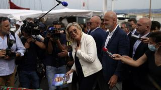 Far-right leader Marine Le Pen gestures as she campaigns at an open air market of Six-Fours-les-Plages, southern France, Thursday, June 17, 2021