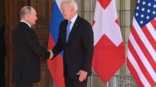 Russian President Vladimir Putin (L) shakes hands with US President Joe Biden prior to the US-Russia summit at the Villa La Grange, in Geneva on June 16, 2021.