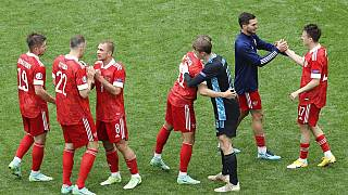 Russia's Aleksei Miranchuk celebrates after scoring the opening goal during the Euro 2020 football championship group B match between Finland and Russia at the Gazprom Arena.