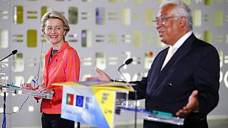 European Commission President Ursula von der Leyen smiles during a joint news conference with Portuguese Prime Minister Antonio Costa, right, at the Center for Living Science