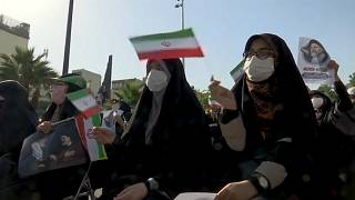 Supporters of Raisi stage campaign rally in Tehran