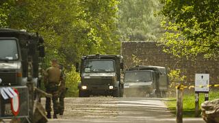 Belgian military carry equipment at the entrance of the National Park Hoge Kempen in Maasmechelen.