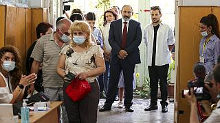 Incumbent prime minister Nikol Pashinyan waits in line to cast his vote in Yerevan on Sunday