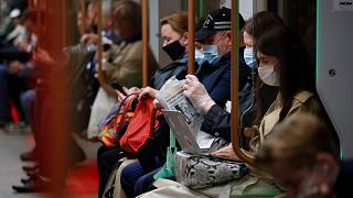 People wearing face mask to help curb the spread of the coronavirus ride the underground in Moscow, Russia June 10, 2021.