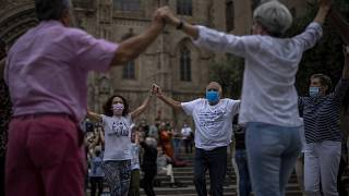 People wearing face masks to protect against COVID-19 perform a traditional Catalan dance in Barcelona, Spain, on June 5, 2021.
