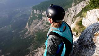Evelina Overling prepares to base jump at Mount Brento