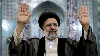 Ebrahim Raisi, a candidate in Iran's presidential elections waves to the media after casting his vote at a polling station in Tehran, Iran Friday, June 18, 2021